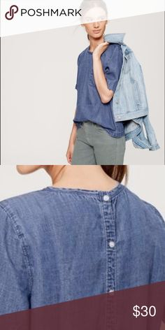 Button Back Chambray Top Finished with a pretty button back, we're feeling the bluesy appeal of this chambray favorite. Jewel neck. Short sleeves. Banded neckline. Patch pocket. Wide cuffs.  NWOT! LOFT Tops