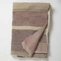 unique hand-woven throw combining natural linen with second hand wool, by catarina riccabona.