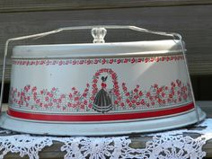 Tin Cake Carrier/holder by dustytiara on Etsy.  I have the matching  breadbox.