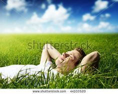 young man in spring grass by Iakov Kalinin, via Shutterstock