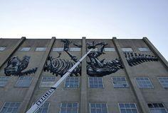 ROA's latest mural, a gigantic T. rex skeleton