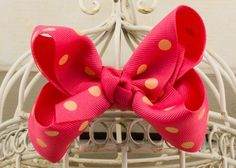 Handcrafted Polka Dot Boutique Bow.  French Pink hair bow with orange cream dots.
