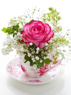 A small arrangement of flowers, displayed in a pretty teacup and saucer, can look amazing.