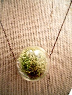 """I'm pretty obsessed with terrariums, succulents, air plants and container gardening.  This may have to come live at my house; around my neck.  """"Live Moss Glass Hanging Terrarium Pendant Necklace. $35.00, via Etsy."""""""