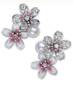 Cherry Blossom Earrings The ornamental Japanese cherry blossom is captured in this pretty floral collection. These earrings feature 6.25mm Akoya cultured pearls, 0.52ct of diamonds, 0.36ct of pink sapphires and glass enamel set in 18k white gold. Mikimoto.