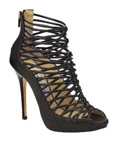 Jimmy Choo Quito Snakeskin Black Platforms. Get the must-have platforms of this season! These Jimmy Choo Quito Snakeskin Black Platforms are a top 10 member favorite on Tradesy. Save on yours before they're sold out!
