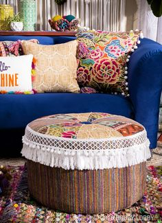"""Round out your home décor with a DIY floor pouf! 1) Cut chair pads in a circle. Stack chair pads to get 15"""" tall. 2) Wrap quilt batting around them. Draw 24"""" diameter circle, add ½"""" seam. 3) Divide circle in 8 equal slices. Add ½"""" seam to each. 4) Cut 2 slices of each fabric & pillow fabric. Sew slices in same order to make circle. 5) Cut 15""""x 80"""" rectangle & circle using striped fabric. 6) Sew rectangle to sliced circle & insert chair pads. 7) Hand sew bottom circle to rectangle & add tasse..."""
