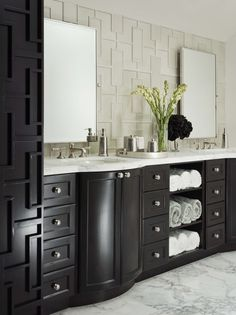 """Walker Zanger's Studio Moderne """"Fretwork Pattern""""    We absolutely love this bathroom! Sophisticated and innovative! Look at how they have copied the tile pattern into the millwork - very cool!"""