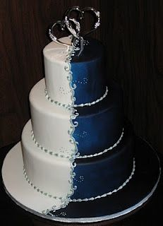 midnight blue and white wedding cake with silver accents and accesories! Looks amazing! Love it heaps!