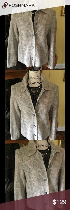 Cream And Gray Leather Jacket This jacket is very soft and I believe it is vintage. Purchased at estate sale. It is Leather shell. Made by J Percy for Marvin Richards. Lining is 100 percent polyester. Sort of a animal or snake skin print to me. Measures about 18 1/2 inches pit to pit when buttoned and 25 inches shoulder to hem. Please no lowball offers as I spend money and a lot of time to find these treasures for you. Thank you for looking. Marvin Richards Jackets & Coats Blazers