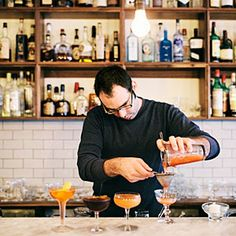 """Essex - """"Chef Brandon Pettit and popular Orangette blogger Molly Wizenberg have opened Essex, a new cocktail bar adjacent to their busy Delancey pizzeria, where diners can lounge while waiting for a table. Jars of unusual housemade mixers (roasted radicchio liqueur?) line the shelves, ready to be used in drinks like the Red Medicine, made with rye, ginger beer, and fernet. The stellar small plates may convince you to skip the pie entirely."""""""