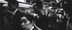 Shinkuju, Japan // by Daido Moriyama. In Shinjuku, Tokyo, corporate salarymen and government officials share the streets with prostitutes, mobsters, and housewives shopping for d...