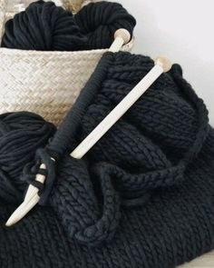 "Pattern for a knit throw blanket in a cool black yarn that is actually ""comprised of midnight blue, forest green, and gray tweed to add a little dimension to the black color"". Would love to make this and use this yarn."