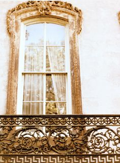 a beautiful balcony but w/french doors that opened to beautiful hills of green & fields of flowers :)