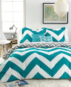 Teal chevron bedspread and other bedroom decorations.