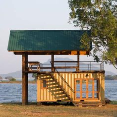 Lakeside retreat in Sri Lanka made using a stray shipping container and timber from weapon boxes. - Maduru Oya  by Damith Premathilake