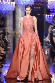 Elie Saab - Fall 2014 - I like the peekout of lace underlayer in the thigh slit.