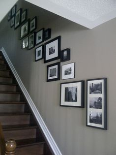 A project for our staircase! Love the black and white photos and frames on the gray wall. Stairway Photos, Stairway Gallery Wall, Staircase Pictures, Gallery Wall Frames, Frames On Wall, Stair Gallery, Picture Frames On The Wall Stairs, Picture Wall Staircase, Gallery Walls