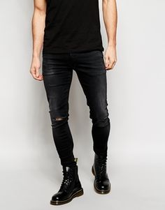 $57, Black Ripped Jeans: Asos Brand Extreme Super Skinny Jeans With Rip. Sold by Asos. Click for more info: https://lookastic.com/men/shop_items/127629/redirect