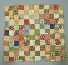 American. Doll's Patchwork Quilt, Late 19th century. Printed cotton squares, 20 1/4 x 19 in. (51.4 x 48.3 cm). Brooklyn Museum, Gift of Peggy Howard, 60.20
