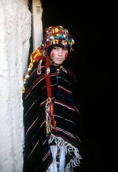 Berber tribeswoman wearing bridal costume, standing in doorway  Morocco Imilchil !