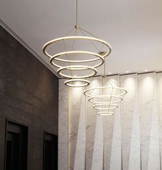 Halo Chandelier - 4 Rings (Brushed brass) — Fashion Tower, New York. Interior by GRT Architects. Image by Joseph de Leo. Designed by Paul Loebach for Roll & Hill