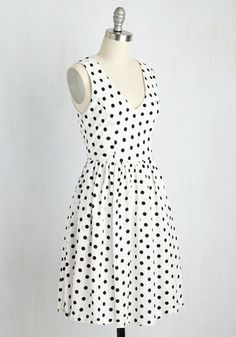 You can never have too many polka dots, and this bright white dress is posh proof! A black pattern complements the princess seams and gathered waist on this darling frock, while a silver zipper and side pockets complete a cute style that's all your own!
