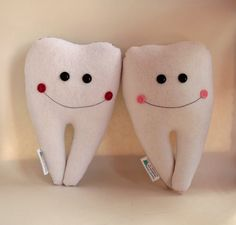 Tooth fairy pillow... I used to have one of these.  There's a little pocket in the back for the lost tooth.  :-)