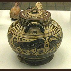 Pyxides (plural of pyxis) were small round lidded boxes used to store trinkets, cosmetics, and ointments. This pyxis is decorated with lions, a goat, a bull and a swan. It is Middle Corinthian, ca. 600 - 575 BC.