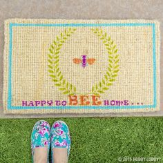 Give your guests a bright and cheerful welcome with a DIY stenciled rug. To make this welcome mat, just use your favorite stencils and add paint to a plain mat!