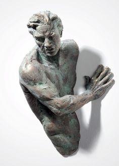 Athletic Bronze Sculptures Emerge from Walls - My Modern Metropolis