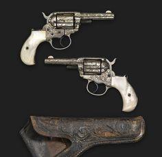 L.D. Nimschke engraved and pearl handled Colt Model 1877 revolver.