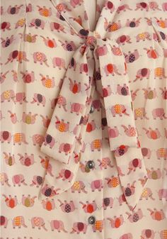 Painted Pachyderms Top - Colorful elephants and a bow tie blouse? Yes please.