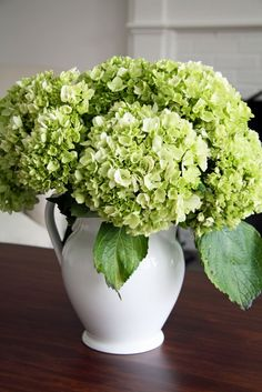 Floral Arrangement of green hydrangea in white pitcher