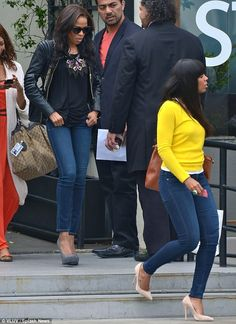Similar style: Michelle Williams, left, and Kelly Rowland, right, both wore skinny jeans and sky-high pumps as they arrived at Bagatelle res...