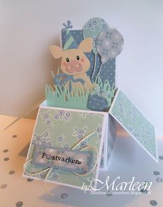 Handmade card-in-a-box by DT member Marleen with Collectables Eline's Piglet (COL1402), Balloons (COL1378), Craftables Grass (CR1355) and Creatables Presents (LR0328) from Marianne Design