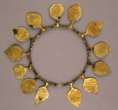 Wreath of poplar leaves (Length: 40 cm) made of gold, lapis lazuli and carnelian, found with the body of a female attendant crouched at the foot of Queen Puabi's bier, Royal Cemetery of Ur, ca 2550 BCE.
