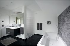 German Brick House Decorating Ideas. Bathroom in classic black and white contrast and hi-tech style