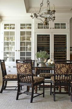 I love this dining room, from the colors and pattern on the chairs to the glass table, and, oh, the wine cooler is devine!
