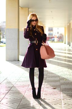 plum coat and pink popping bag. pleasantly paired.
