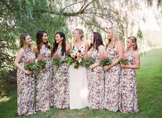 Gorgeous floral bridesmaid gowns: http://www.stylemepretty.com/california-weddings/temecula/2016/04/08/california-bride-groom-create-a-destination-wedding-near-home/ | Photography: Chloe Moore - http://www.chloemoorephotography.com/