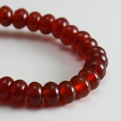 Carnelian Beads 6mm Rondelles   30 beads by desertfiresupplies.  I have these in rounds, not rondelles.