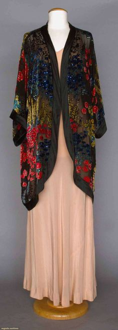 CUT VELVET EVENING COAT, 1920s. Blue, coral & yellow flowers cut to black chiffon, scattered sequins, 3/4 length kimono sleeves, black silk satin edge trim. (hva)