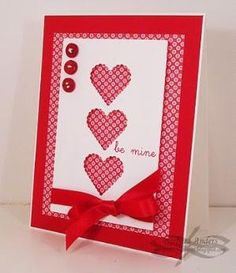 handmade Valentine card ... three layered panel ... negative heart die cuts expose patterned paper below... like it!! by chelsea