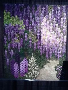 Amazing!  Lovely purple wisteria , and I first pinned it as Wisteria ...a living plant !!!