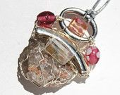 Pink Inukshuk and MUSKOKA STONE wire wrapped pendant is made with stirling silver wire and glass or resin beads and pewter pieces.