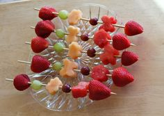 fruit skewers with butterflies and flowers - I like the idea of flower shaped fruit skewers