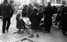 Lodz ghetto, Poland 1940—1944. Street vendors. (Children in the Holocaust - Working)