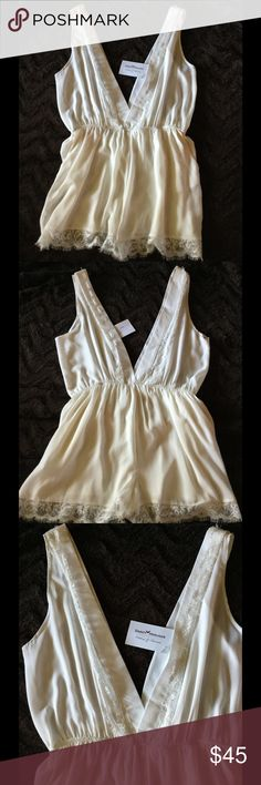 NWT Dainty Hooligan White lace sexy romper Sz. L Perfect condition. New with tags! Dainty Hooligan brand. White with beautiful lace trim. Sz. L (runs small. Fits more like a medium.) Dainty Hooligan Tops Tunics