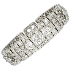 16.00 Carat Old European Cut Diamond Art Deco Bracelet. Platinum Art Deco flexible bracelet consisting of approximately 16.00 carats total weight of Old European cut diamonds, center stone weigh approximately 2.00ct.